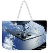 A B-2 Spirit Moves Into Position Weekender Tote Bag by Stocktrek Images