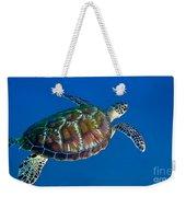 A Black Sea Turtle Off The Coast Weekender Tote Bag by Michael Wood