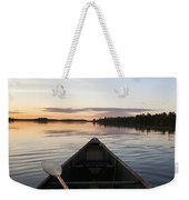 A Boat And Paddle On A Tranquil Lake Weekender Tote Bag