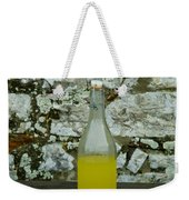 A Bottle Of Limoncello Sits On A Picnic Weekender Tote Bag