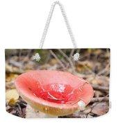 A Bright Red Mushroom Blooms Weekender Tote Bag