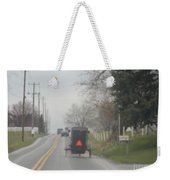 A Buggy Travels Down A Road In Spring Weekender Tote Bag