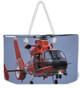 A Coast Guard Mh-65 Dolphin Helicopter Weekender Tote Bag by Stocktrek Images
