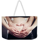 A Couple Touching Belly In A Heart Shape. Weekender Tote Bag