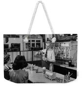 A Druggist Prepares Ice Cream Floats At A Soda Fountain Weekender Tote Bag