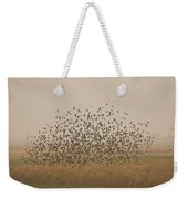 A Flock Of Birds Swarming A Field Weekender Tote Bag