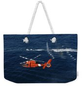 A Helicopter Crew Trains Off The Coast Weekender Tote Bag by Stocktrek Images