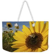 A Honey Bee Visiting A Sunflower Weekender Tote Bag