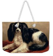 A King Charles Spaniel Seated On A Red Cushion Weekender Tote Bag