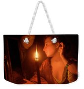 A Lady Admiring An Earring By Candlelight Weekender Tote Bag