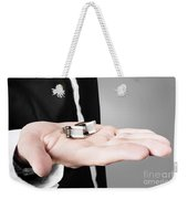 A Male Model Showcasing Cuff Links In His Hand Weekender Tote Bag