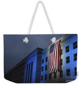 A Memorial Flag Is Illuminated On The Weekender Tote Bag