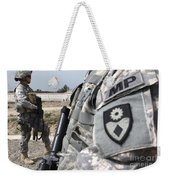 A Military Police Officer Provides Weekender Tote Bag by Stocktrek Images