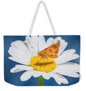 A Moth Collects Pollen On A Single Daisy Blossom. Weekender Tote Bag