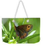 A Red Butterfly Perching  Weekender Tote Bag
