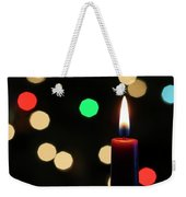 A Red Christmas Candle With Blurred Lights Weekender Tote Bag