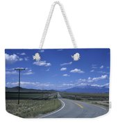 A Road Disappears Into The Distance Weekender Tote Bag