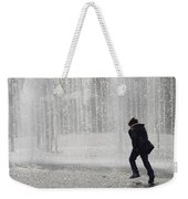 A Silhouette Of The Boy Against A Fountain Weekender Tote Bag