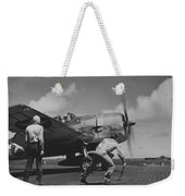 A Us Navy Fighter Pilot Gets The Take Off Flag From The Deck Crew Of An Aircraft Carrier Weekender Tote Bag