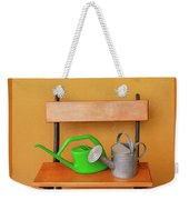 A Watering Can Of  Aluminium And A Plastic One Laid On Wooden Bench Weekender Tote Bag