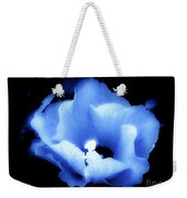 A White Hibiscus Bloom With Blue Tinge On Black Background Weekender Tote Bag