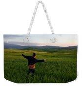 A Young Boy Runs Through A Field Weekender Tote Bag