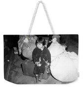 A Young Evacuee Of Japanese Ancestry Weekender Tote Bag by Stocktrek Images