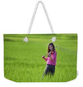A Young Girl In A Folk Costume Plays A Vivaro In A Green Rice Fi Weekender Tote Bag