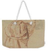A Young Woman Looking In A Mirror Weekender Tote Bag