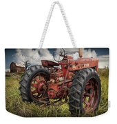 Abandoned Old Farmall Tractor In A Grassy Field Weekender Tote Bag
