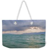 Amazing View Of Azure Sky Over Rippled Surface Of Cold Sea At Sunrise Weekender Tote Bag