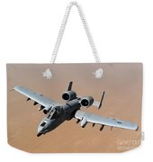 An A-10 Thunderbolt II Over The Skies Weekender Tote Bag