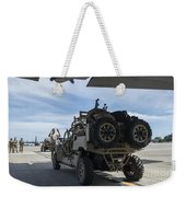 An All-terrain Vehicle Is Guided Onto Weekender Tote Bag