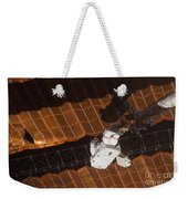 An Astronaut Anchored To A Foot Weekender Tote Bag
