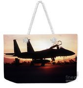 An F-15c Eagle Aircraft Silhouetted Weekender Tote Bag by Stocktrek Images