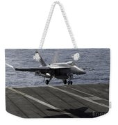 An Fa-18e Super Hornet Prepares To Land Weekender Tote Bag by Stocktrek Images