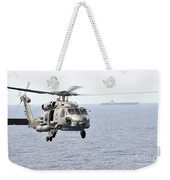 An Mh-60r Seahawk Helicopter In Flight Weekender Tote Bag