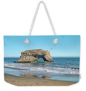 Arch In The Sea With Pelicans Flying By, At Natural Bridges State Beach, Santa Cruz, California Weekender Tote Bag