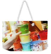 Artist Reaching For A Liquid Paint Container. Weekender Tote Bag