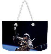 Astronaut Floats In Space Weekender Tote Bag