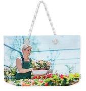 Attractive Gardener Selecting Flowers In A Gardening Center. Weekender Tote Bag