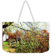 Autumn Leaves Against A Fence Weekender Tote Bag
