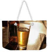 Backlit Glass Of Beer And Empty Bottle On Table Weekender Tote Bag