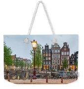Bikes And Houses Along Canal At Dusk Weekender Tote Bag