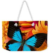 Blue Butterfly On Brightly Colored Flowers Weekender Tote Bag