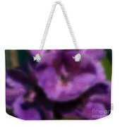 Blurred Seasonal Orchid Flowers With Dark Green Background Weekender Tote Bag