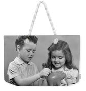 Boy And Girl Putting Money Into Piggy Weekender Tote Bag