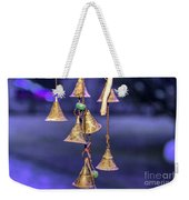Brass Bells Hanging In The Illuminated Courtyard At Winter Night Weekender Tote Bag