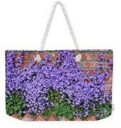 Brick Wall With Blue Flowers Weekender Tote Bag