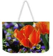 Brilliant Bright Orange And Red Flowering Tulips In A Garden Weekender Tote Bag